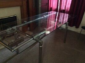 Smoked glass extendable dining table and chairs