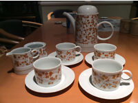 Set of four cups with jug, sugar bowl and milk jug