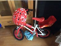Fab girls Minnie Mouse bike with matching helmet. Stabilisers with bike