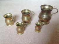 Brass antique tankard set