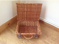 Small empty wicker picnic basket