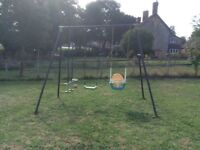 Two swings and a seesaw set