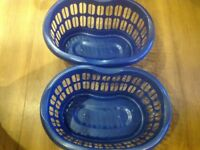 Blue plastic laundry baskets