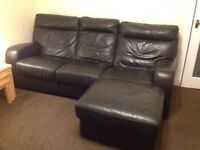 For sale three seater and two seater suite with foot on and electric recliner Dark brown leather