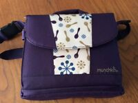 Munchkin portable travel seat