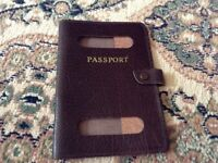 Old style large size passport holder.