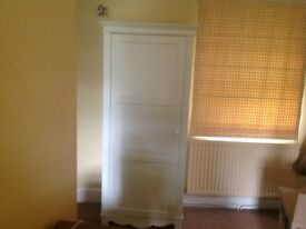 Wardrobe with hanging rail and shelves
