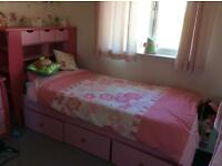 Girls full size pink single bed and shelves