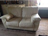 Two seater cream leather sofa VGC