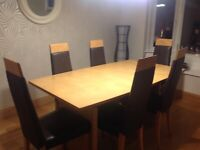 Oak Dining table and 6 Oak / Genuine Leather chairs