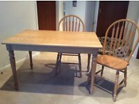 Solid wood, limed oak table with two matching chairs. Bought from John Lewis.