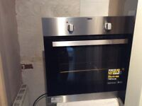 Zanussi ekectric oven less than 6 months old, fully working, in black