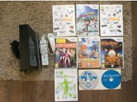 Black Nintendo wii with 9 games.