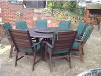 8 seater Lazy Days round garden table and chairs. High quality hard wood.