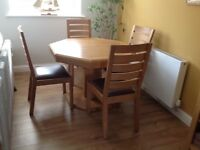 Octagonal dining table and chairs.
