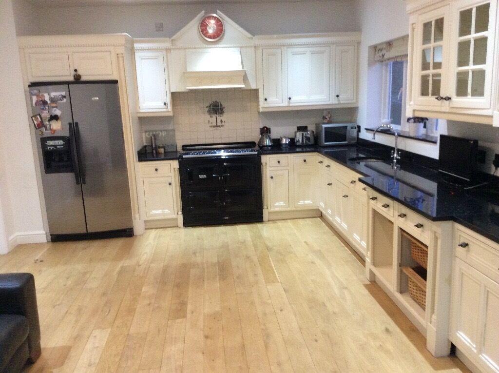 Cream Wood Kitchen Units With Black Granite Worktop In