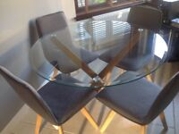 Beautiful solid Oak and Glass Dining Table ....brand new still in box