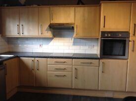 Kitchen with 9kg washing machine,dishwasher,tumble dryer,oven,hob,hood,units,doors,worktop.