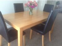 4-6 seater table and 4 faux leather chairs £75