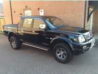 L200 Trojan 2.5 TD twin cab truck , very last of the old shape in black with black leather.