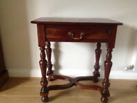 A lovely solid wood side table