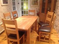 High quality dining table & 6 chairs,solid wood excellent condition 18 months old.