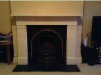 Collection - Marble Fireplace Surround and Inset Cast Iron Fireplace