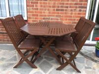 Garden table & 4 chairs. Solid hard wood in good condition