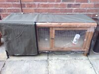 Brand new, never used guinea pig hutch with thermal cover.