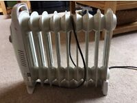 Small Rolson oil heater. Idea for caravans and conservatories.