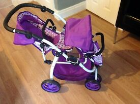 Excellent condition double toy pram. Purple