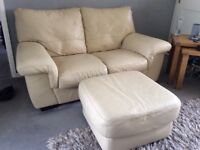 Beige leather 2 seater sofa and footstool,good condition.