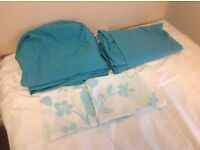 twin bedding in white and turqoise duvet covers and pillowcases plus fitted sheets