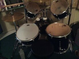 Drum kit including silencers