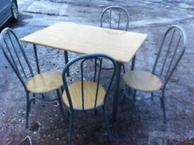 Lovely bistro style dining table with four matching chairs