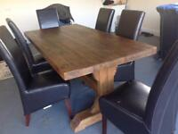 Solid kitchen/dining room table with six leather chairs