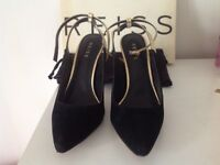 Brand new black with gold straps high heels, size 6 Reiss shoes. Heels high 10cm, very comfortable.