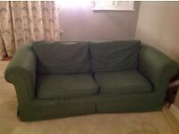 Two large green fabric sofas