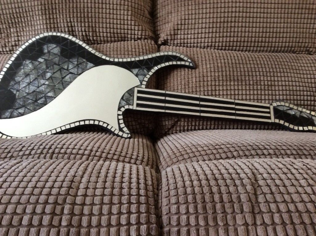 Guitar tiled and mirrored