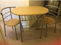 Table and chairs- Good condition- ideal for a new home!