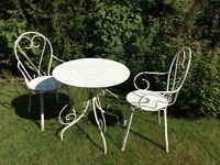 Garden table and two chairs