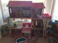 Large fort style pink wooden dolls house
