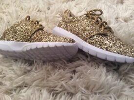 Brand new gold glitter trainers