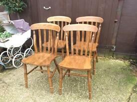 Four matching wooden kitchen dining chairs