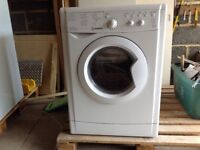 Gas hob, electric under counter oven and combination washing machine/tumble drier