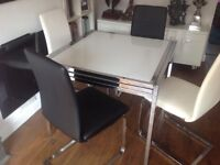 Barker &Stonehouse glass table and 4 chairs.