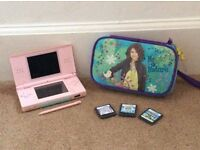 Nintendo DS in excellent condition, along with three games, case and charger