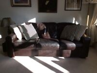 "Dark brown leather sofa in perfect condition. Measures w 83""x h 31"" x w37"". Height of seating 18""."