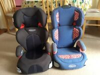 Two high backed booster seats