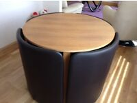 Compact table and storage chairs. Good conditon